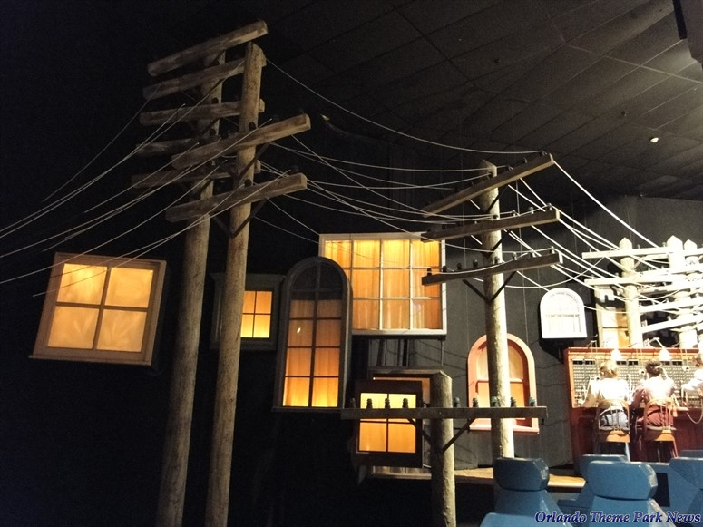 Spaceship Earth scene showing the telephone poles and wires outside homes