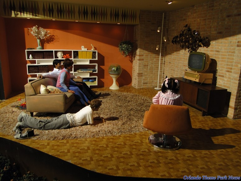 Spaceship Earth updated scene of family in living room.