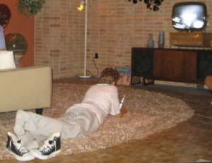 Current Spaceship Earth TV scene for reference of boy on the carpet watching TV