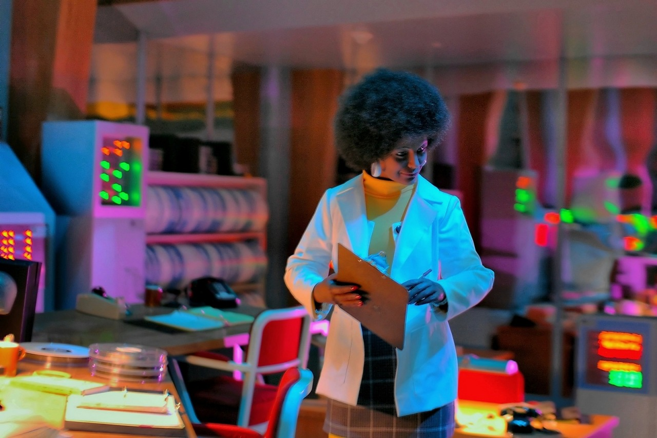 Spaceship Earth scene of black woman working in a lab coat in the mainframe office