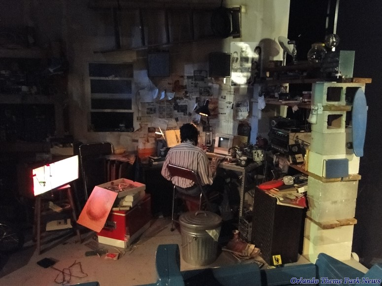 Spaceship Earth scene of a computer programmer working inside a messy garage