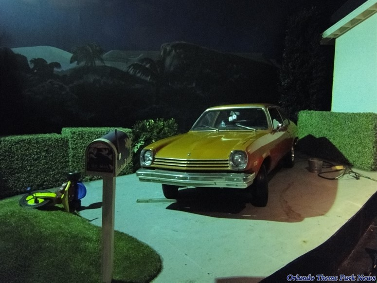 Spaceship Earth scene of car outside of garage in the burbs